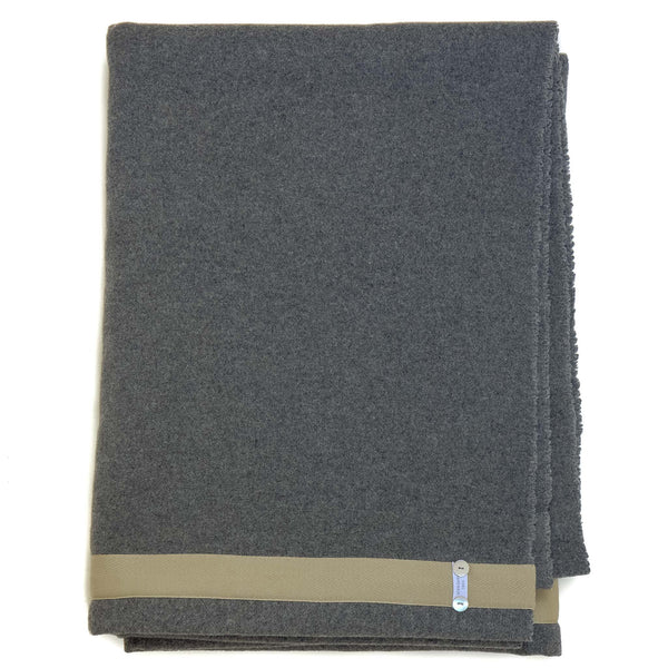 dark grey wool blanket with an edging of taupe sewn along it
