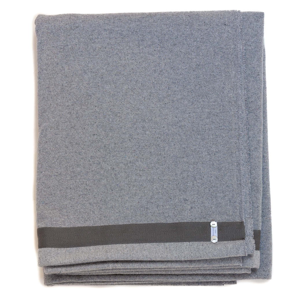 light grey blanket with charcoal edge detail
