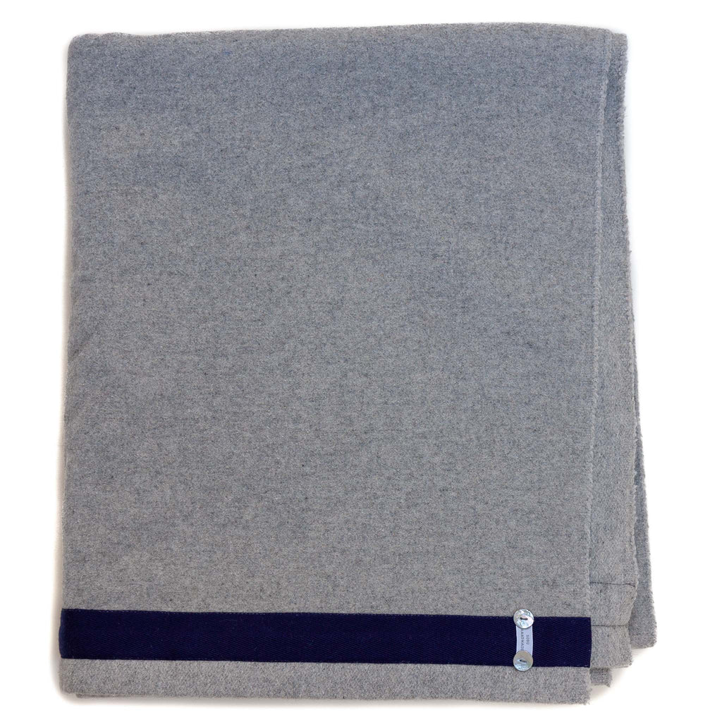 light grey blanket with navy blue edge detail