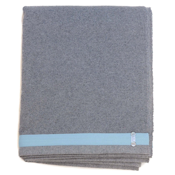 light grey blanket with light blue edge detail