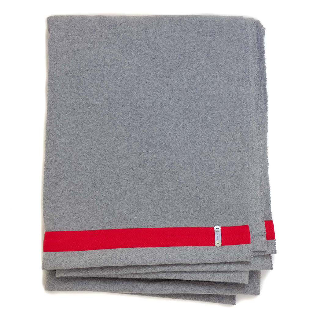 light grey blanket with red edge detail