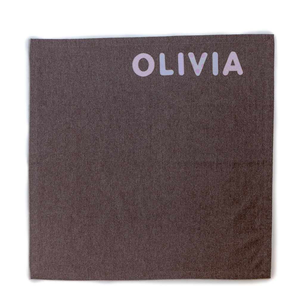 small taupe personalised blanket for a baby with the name Olivia sewn in pink into it