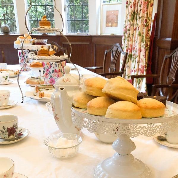 afternoon tea with scones, finger sandwiches, cakes and vintage china