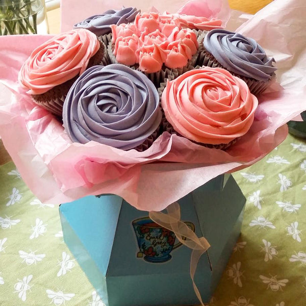 bouquet of pink and purple cupcakes tied like a bunch of flowers
