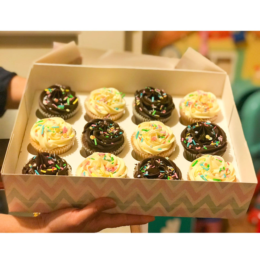 box of decorated cupcakes