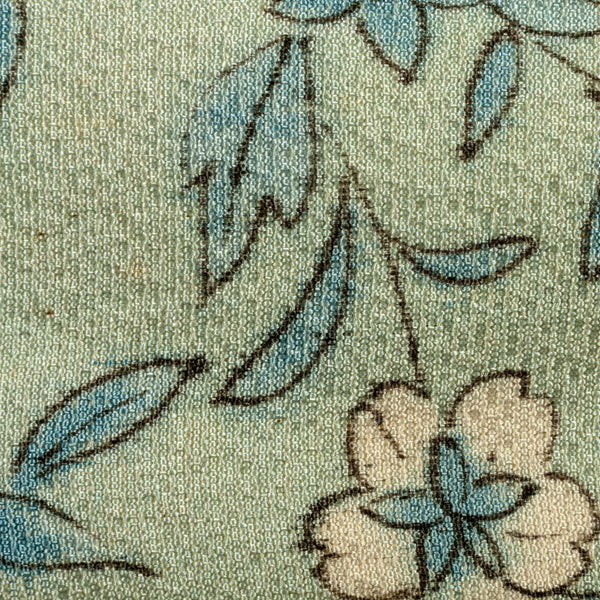 detail of a headband with a blue flower pattern made from vintage kimoni