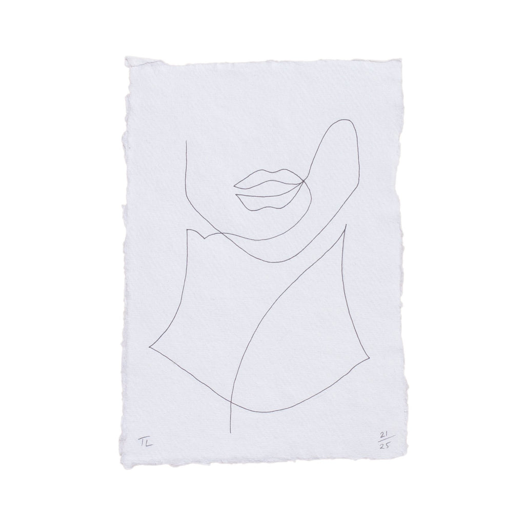hand drawing of a womans face on a white piece of paper