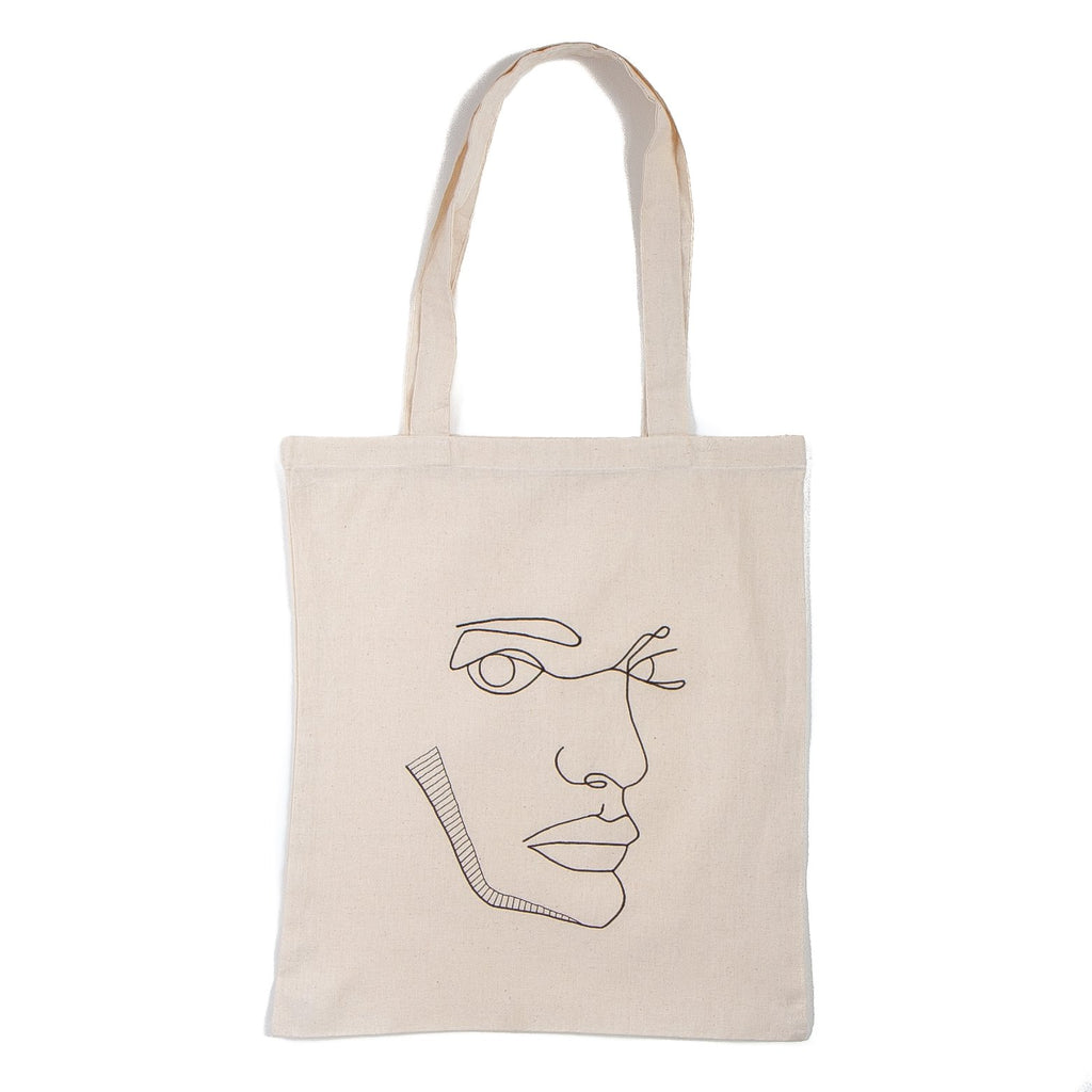 natural coloured tote bag with a black outline of a mans face screenprinted onto it