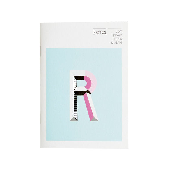 a notebook with the letter R designed on the front in a monogram print