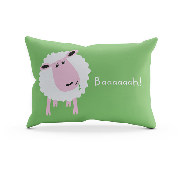 a green pillowcase with a white sheep eating grass and the words baaa printed on it