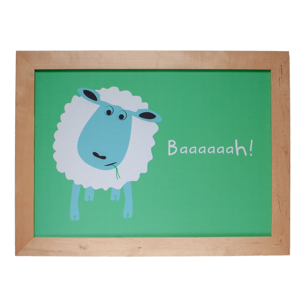 a framed print of a white sheep on a green background