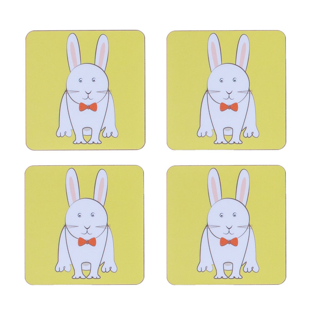 four piece childrens yellow dining table coaster set with a rabbit printed on it