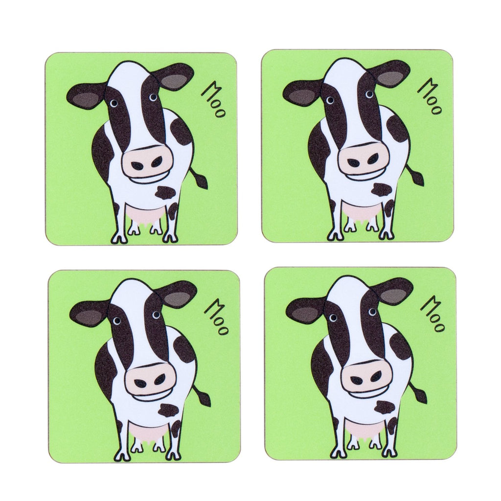 four piece childrens green dining table coaster set with a cow printed on it