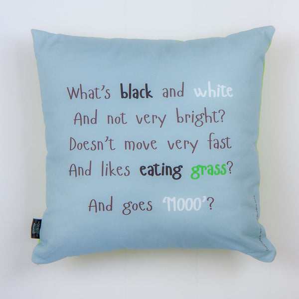 blue cushion with a rhyme about cows printed on it