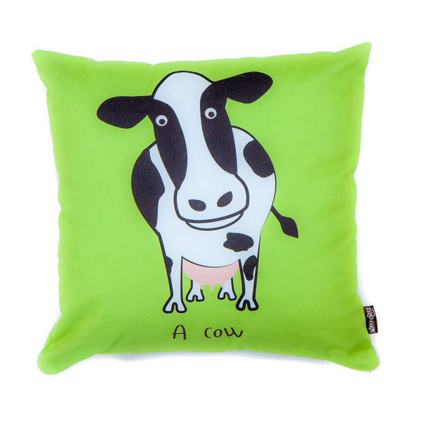 green cushion with a cow printed on it