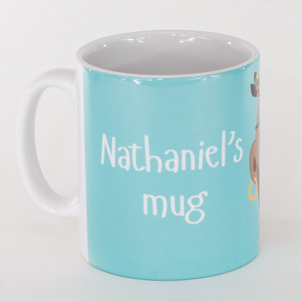 back of a personalised childrens blue mug with the words nathanials mug printed on it