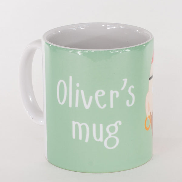 back of a personalised childrens green mug with the words olivers mug printed on it
