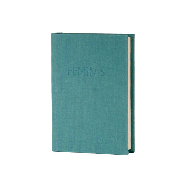 duck egg blue coloured A6 handmade notebook with the quote feminist printed on it