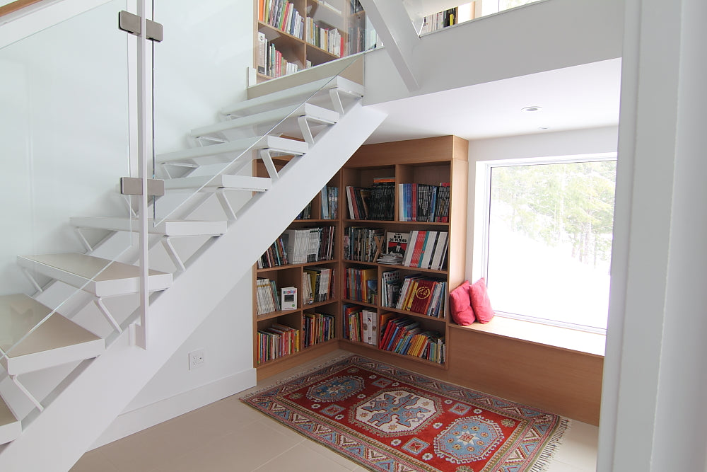 One More Home Library Under The Stairs Idea, This Time With A Comfortable  Reading Spot Near The Window Sill.