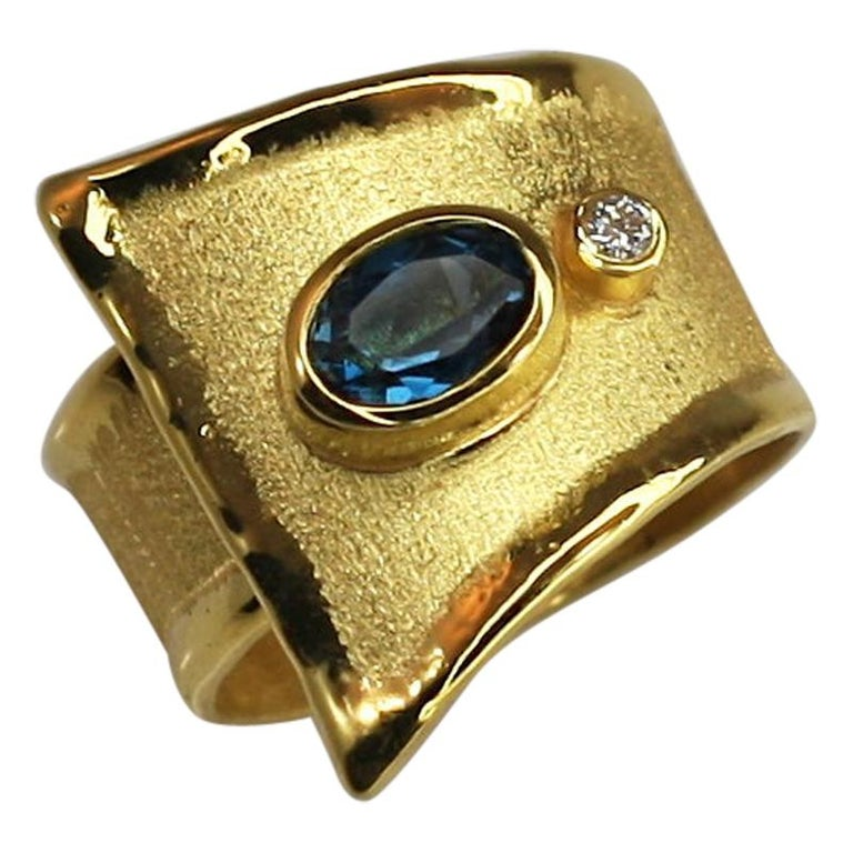 MIDAS Blue Topaz and Diamond Ring in 18 Karat Yellow Gold