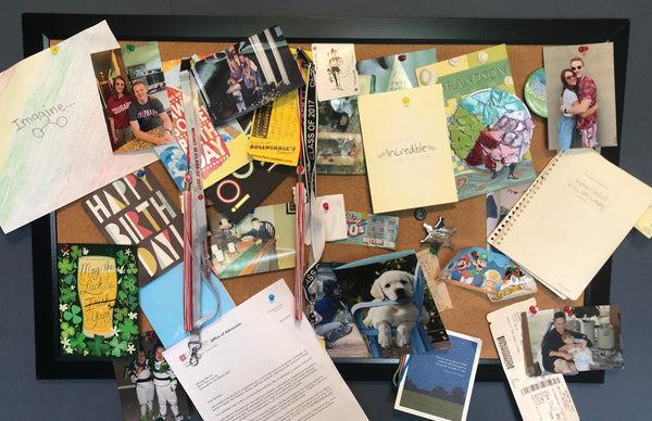 College student's bulletin board filled with notes and memorabilia