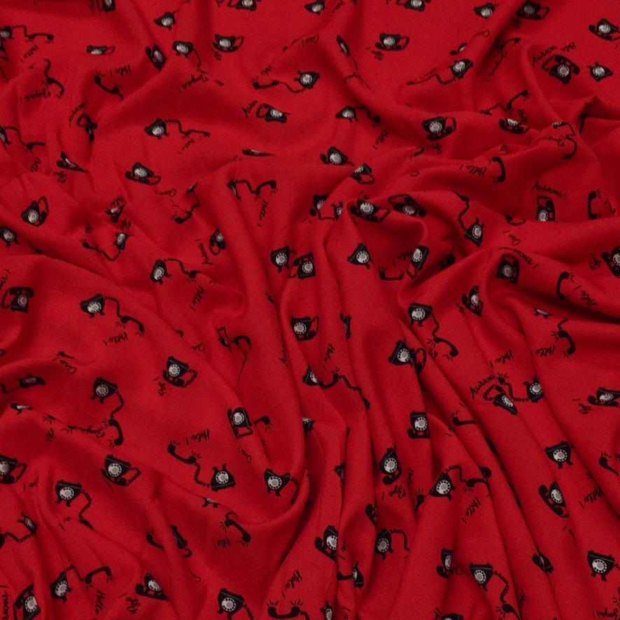 Black Telephones on Red Viscose Fabric