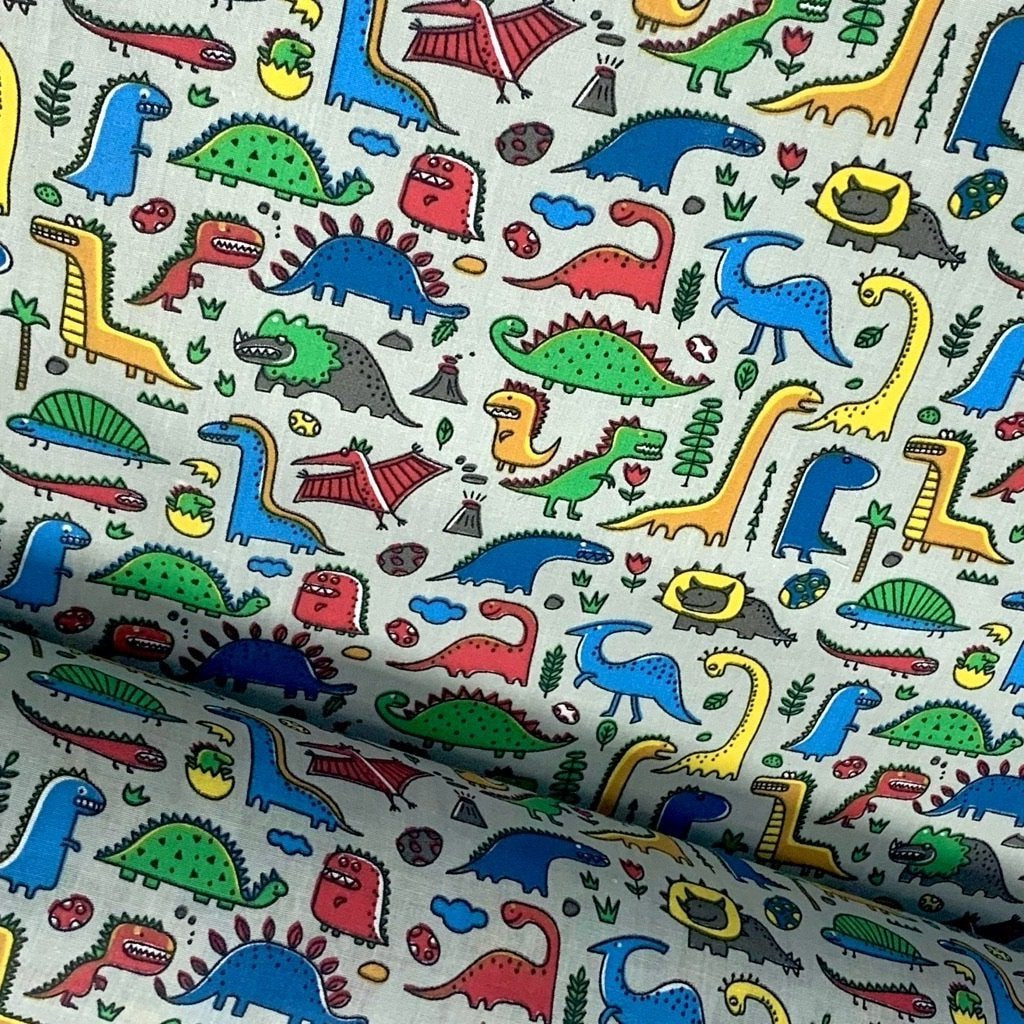Silver Dinosaurs Collage Polycotton Fabric