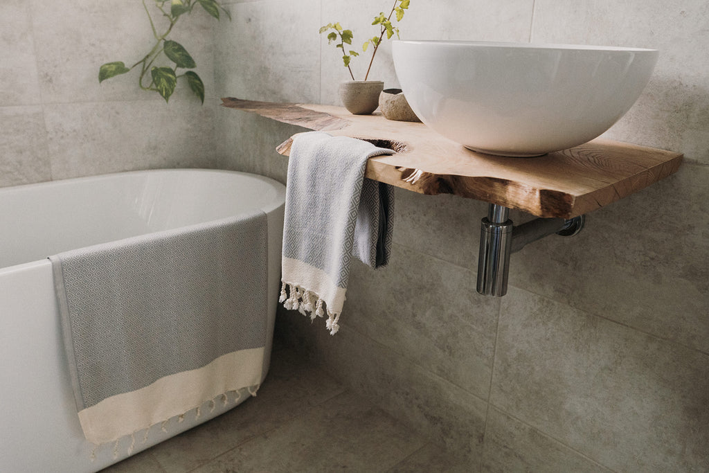 Arc Lore ultra soft and quick to dry organic cotton bath sets in the colour light grey with diamond patterns drying in the bathroom