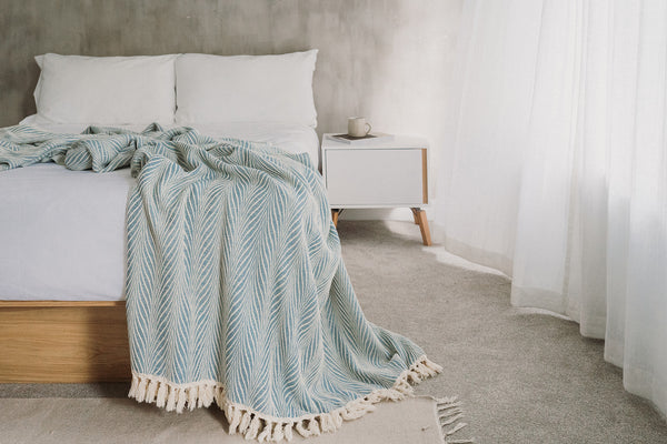 Arc Lore organic super king size bed throw in the colour teal spread over a bed