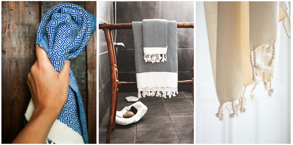 Small towel in blue and oatmeal with a set in matching black hanging on a bath rack