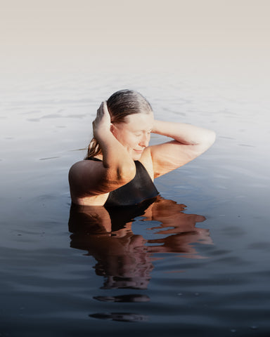 A wild swimmer swimming in a lake in East Sussex