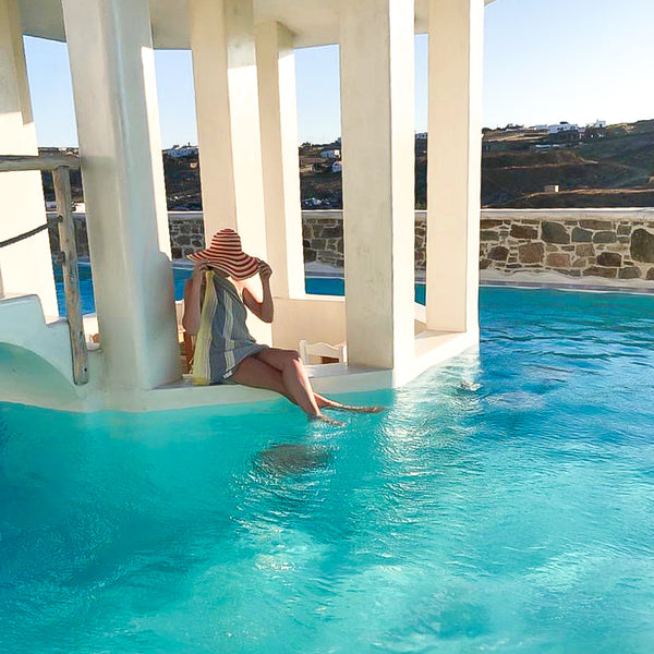 Yalo organic towel by the pool in Santorini used as a sarong