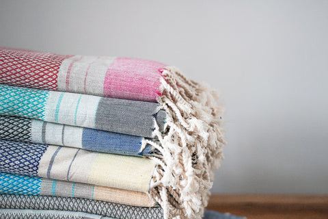 beautiful stack of organic cotton towels in five different colours