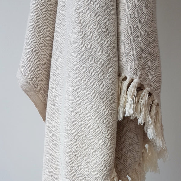 Arc Lore Aegean organic cotton bed throw in the colour wheat with a subtle woven pattern