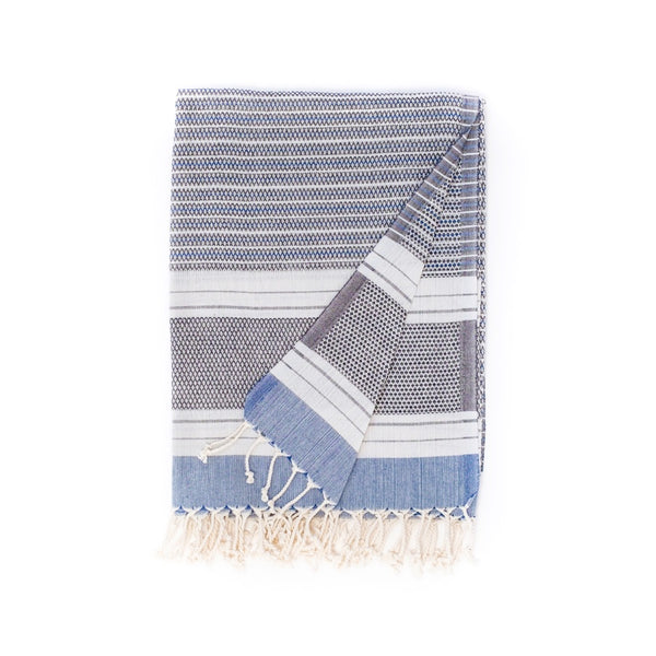 Arc Lore Hara organic cotton travel towel in the colour black blue with woven patterns and stripes