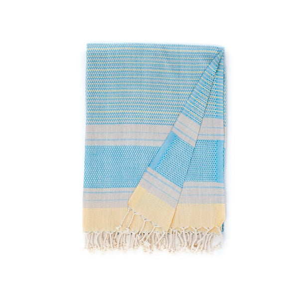 Arc Lore Hara organic cotton travel towel in the colour aqua lemon with woven patterns and stripes