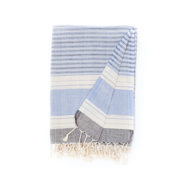 Arc Lore Hara organic cotton travel towel in the colour grey blue with woven patterns and stripes