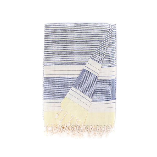 Arc Lore Hara organic cotton travel towel in the colour navy lemon with woven patterns and stripes