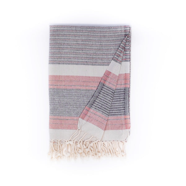Arc Lore Hara organic cotton travel towel in the colour red grey with woven patterns and stripes