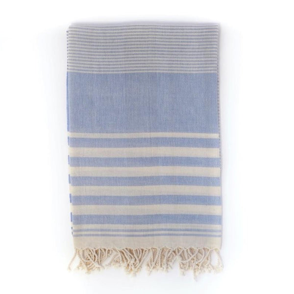 Arc Lore Mydo organic cotton beach towel in a blue colour with bold stripes.