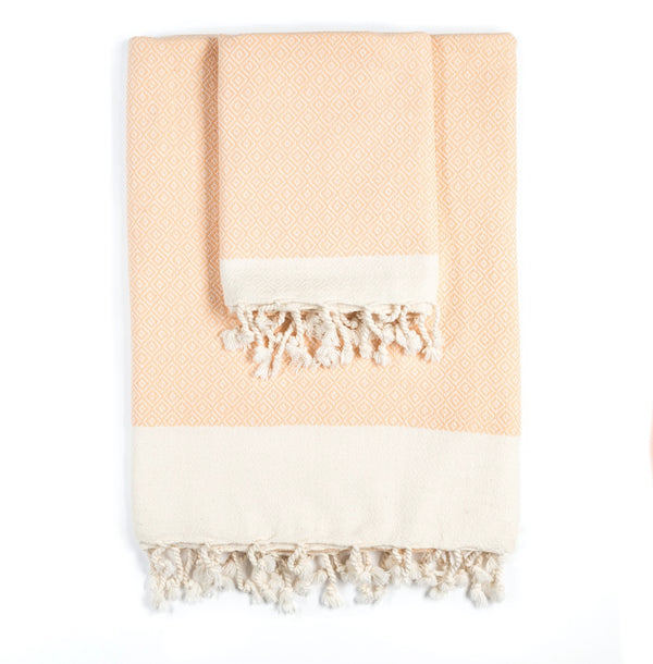 Arc Lore Samimi organic cotton bath towel set in the colour apricot with woven diamond patterns