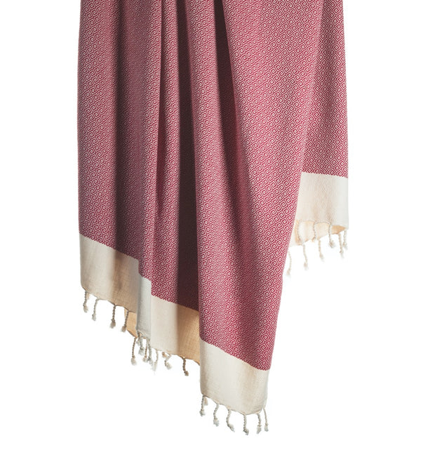 Arc Lore Samimi organic cotton bath towel in the colour berry red with woven diamond patterns