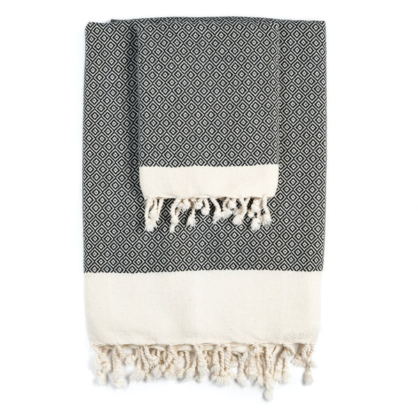 Arc Lore Samimi organic cotton bath towel set in the colour black with woven diamond patterns.