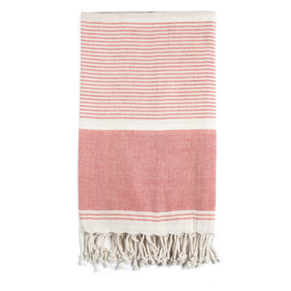 Mydo organic cotton beach towel by Arc Lore in grapefruit colour with white stripes.