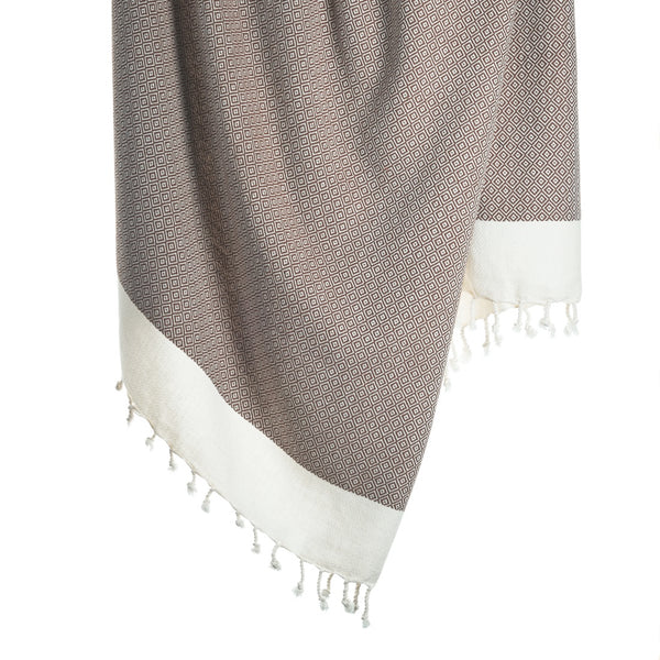 Lightweight organic cotton bath towel in hazelnut with diamond patterns and a white border