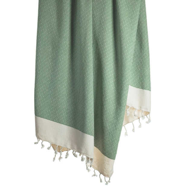 Arc Lore Samimi organic cotton bath towel in the colour sage green with woven diamond patterns