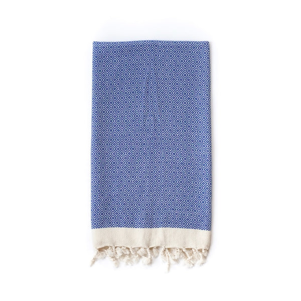 Arc Lore Samimi organic cotton hair towel in the colour bright blue with woven diamond patterns