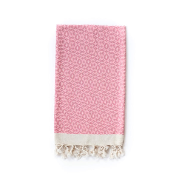 Arc Lore Samimi organic cotton hair towel in the colour hot pink with woven diamond patterns