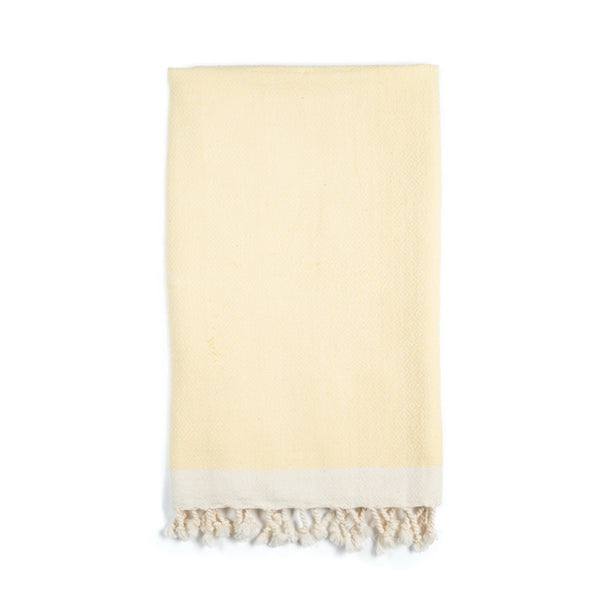 Arc Lore Samimi organic cotton hair towel in the colour lemon yellow with woven diamond patterns