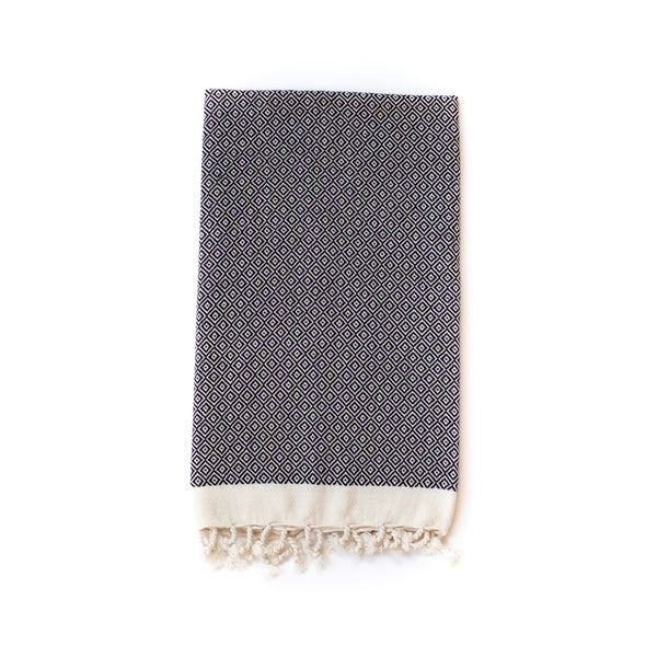Arc Lore Samimi organic cotton hand towel in the colour black with woven diamond patterns